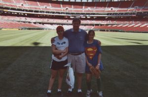 Keith and his twin daughters at Busch Stadium in St. Louis.